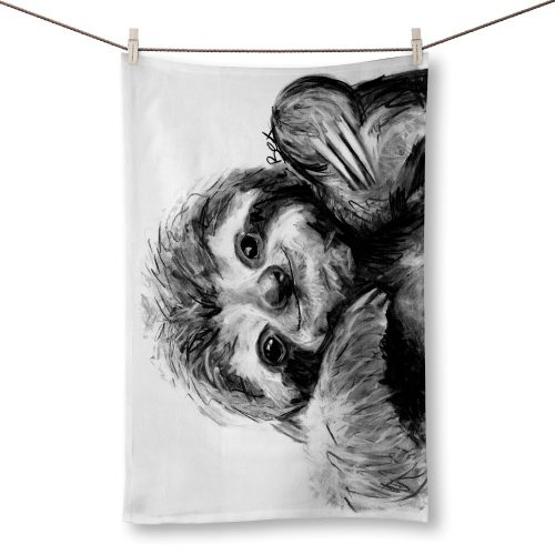white teatowel with a charcoal grey and white sloth on it