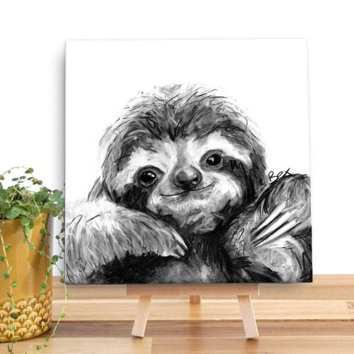 canvas with a charcoal grey and wihite sloth on it