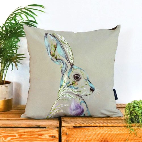 Plain neutral square cushion with a pastel coloured hare on it.