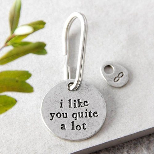 """Round metal keyring iwth """"i like you quite a lot"""" engraved on it"""