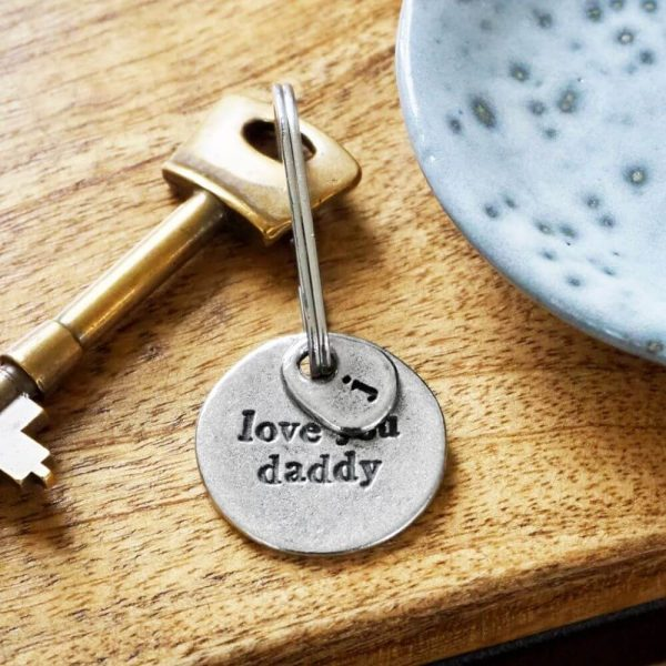 """""""love you daddy"""" keyring displayed with a key attached"""