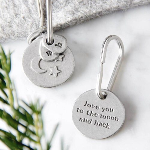 """Round metal key ring with """"Love you to the moon and back"""" on one side and raised pictreu"""