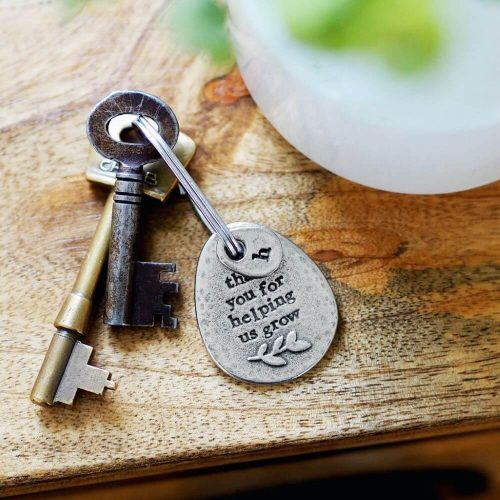 Tear drop shaped metal keyring with engraved message