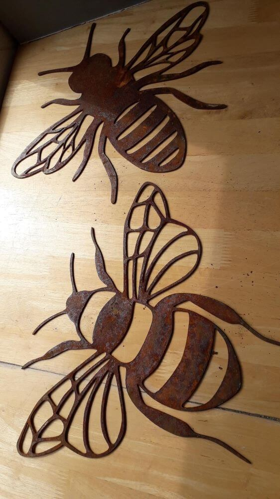 two rusty cut out bees