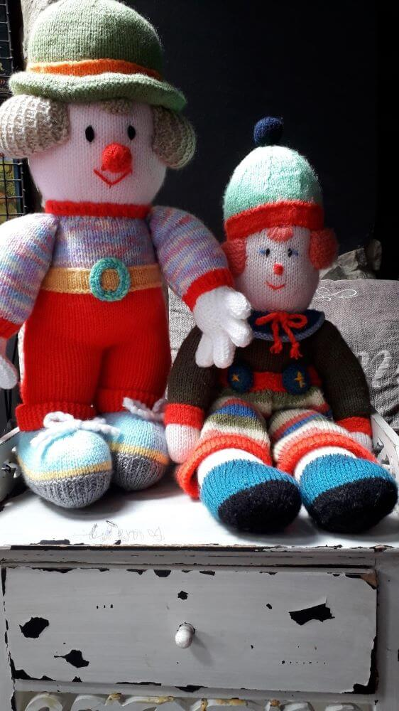 Knitted clows with knitted colourful knitted outfits, hats, hair and red nose