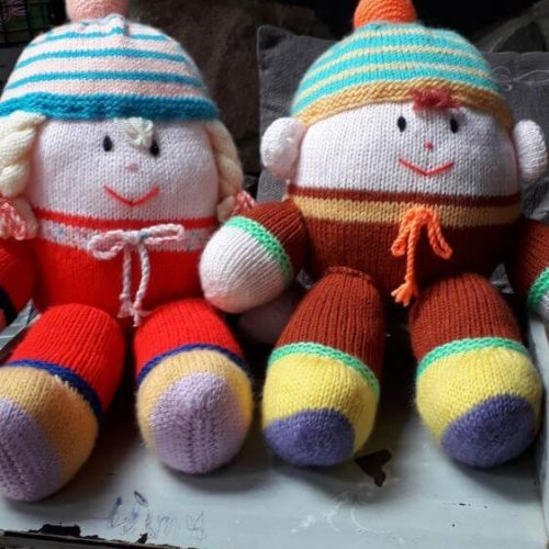Sitting humpty dumpty with dungarees and boots build in to knit design