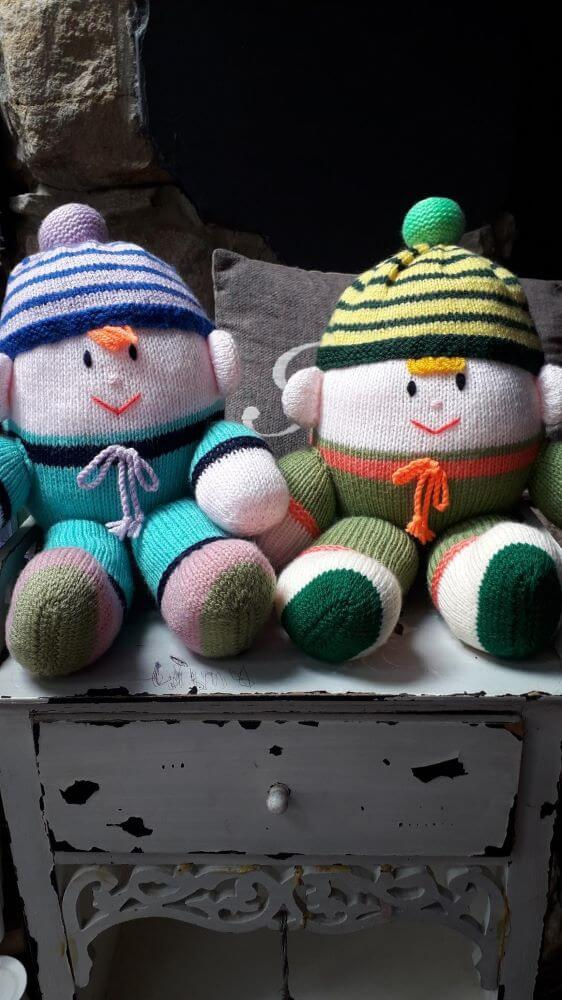 Hand knitted humpty dumpty. Differing colours with stripped hats with pom poms